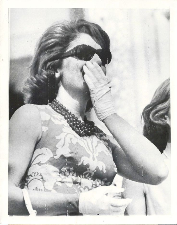 Mrs. Jacqueline Kennedy, wife of the President of the United States, claps her hand to her face as she watches Indian divers during exhibition in her honor. Near Agra, India - March 15, 1962.