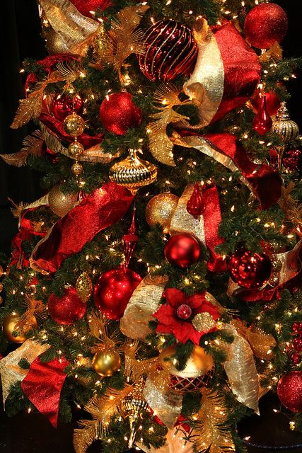 red and gold christmas tree decorations via flickr