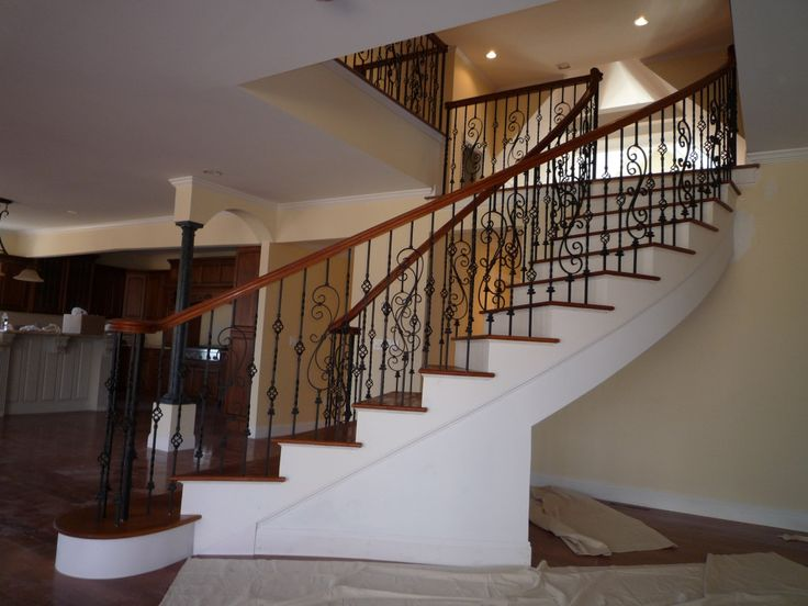 Charming Iron Balusters For Upgrading Your Home Interior Design: Cool Curved Staircase Design With Iron Balusters And Handrails Also Area Rug