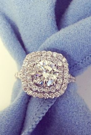 Cushion shaped double halo engagement ring featuring a round brilliant cut diamond with a double shank