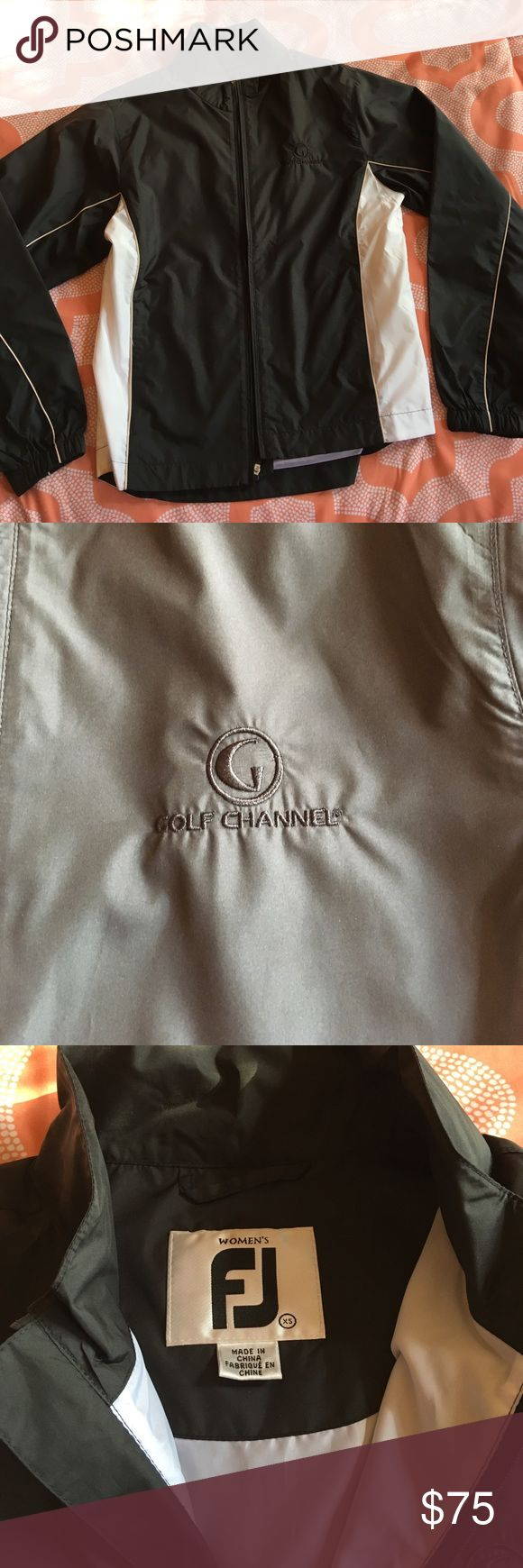 Brand new FootJoy Golf Jacket BRAND NEW/NEVER BEEN WORN FootJoy golf jacket in black and white. Golf Channel logo on front and FJ logo on back. Feels like the material from a windbreaker. Full zipper in front. FootJoy Jackets & Coats