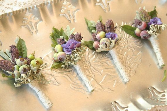 Boutonnieres, blueberries, purple hydrangea, lavender, dusty miller and wisteria foliage.