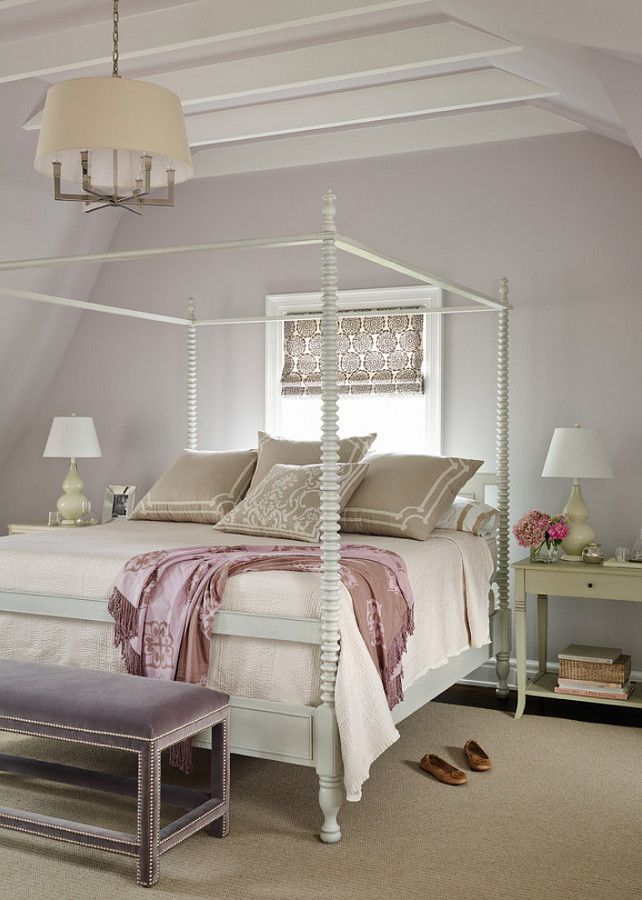 White canopy bed with creamy pink accents