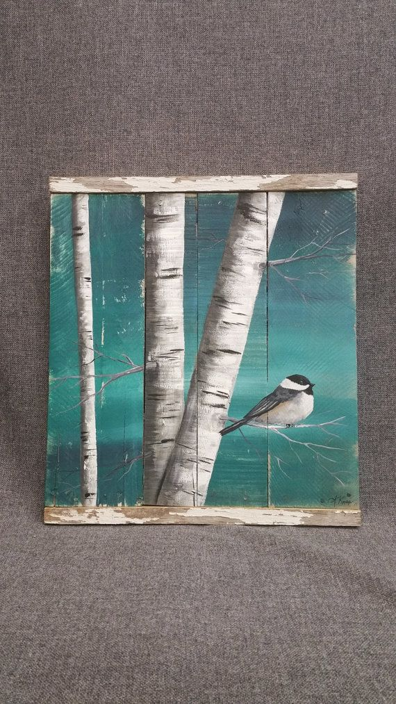 Hand painted White Birch, wall decor, chickadee Bird, Reclaimed Wood Pallet Art, Rustic and Shabby Chic  Dimensions are approx. 16 1/2 inches wide x 19 1/2 inches high Original painting on wood. This unique piece is 3 pieces of reclaimed wood connected together, painted a medium grey, and slightly aged. Using acrylic paints, I hand painted the birch trunks, and a chickadee. The top and bottom is accented with a strip of old, peeling white painted barn wood.  All of my creations are made of…