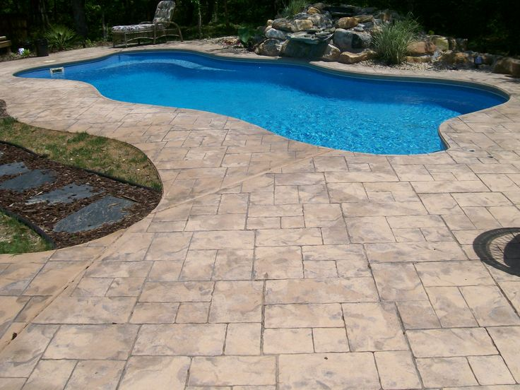 Stamped concrete swimming pool pool deck with complete color stamping and formed with Diy resurfacing concrete swimming pool deck ideas