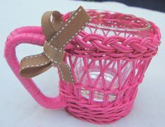 wicker and glass candle holder