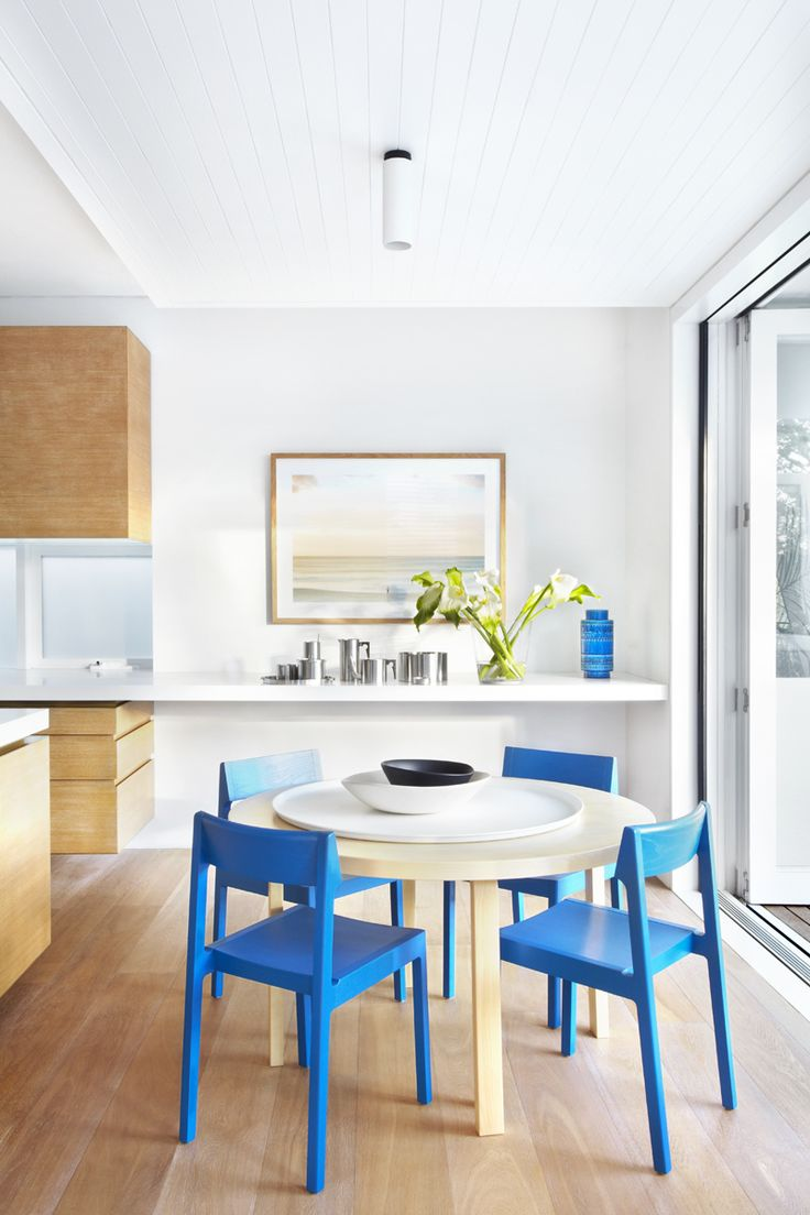 blue chairs in white kitchen, by Pohio Adams Architects