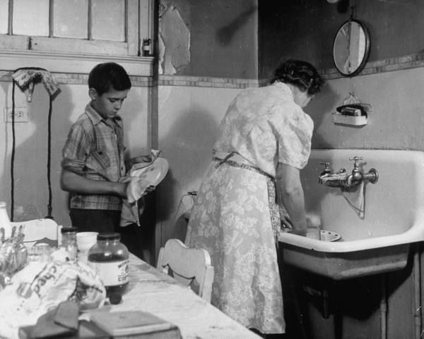 best photographer alfred eisenstaedt images  boy helping his mother the dinner dishes from essay an american block re small town block in wartime