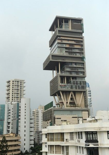 Antilia, Mumbai, India Owner: Mukesh Ambani, worth $21.5billion Value: upward of $1 billion The twenty-seven story, 400,000-square foot skyscraper residence, named after a mythical island in the Atlantic, has six underground levels of parking, three helicopter pads, a 'health' level, and reportedly requires about 600 staff to run it. It is the world's most expensive home far and away with construction costs topping $1 billion.