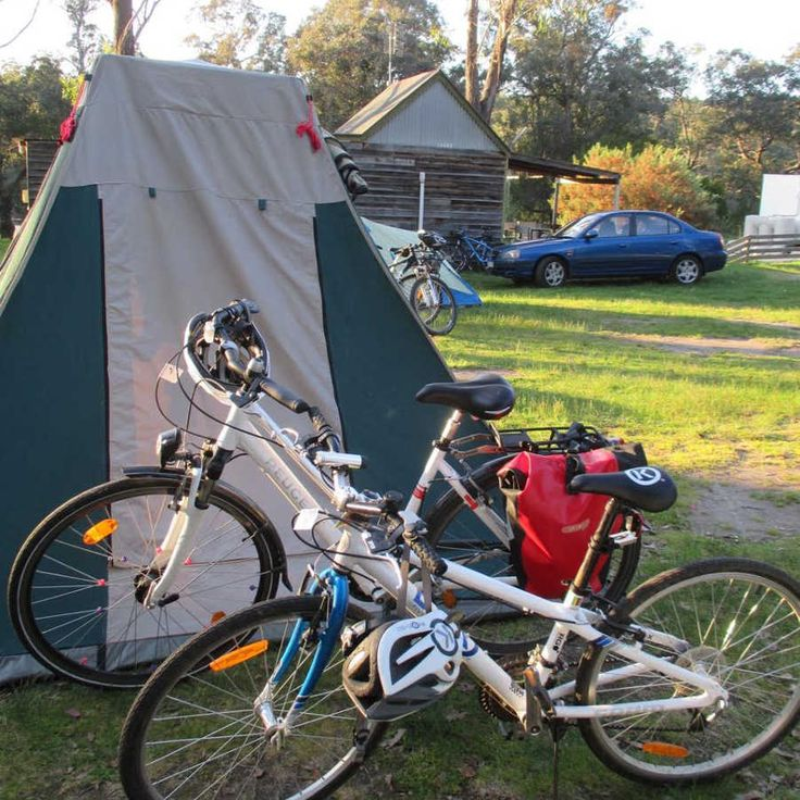 Miles and Mum's Bikes in front of their tent