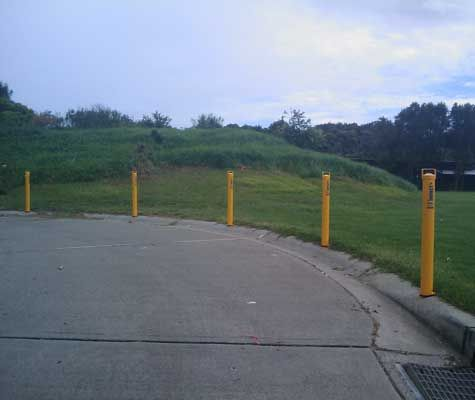 Spartan locking and removable bollards protecting public lands. Bollards manufactured from galvanised steel which is also powder coated for safety.