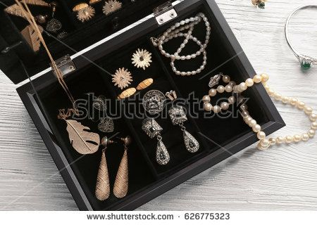Jewelry accessories in box and table, top view