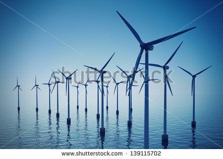 Alternative energy- shot of floating wind turbine farm during foggy day. - stock photo