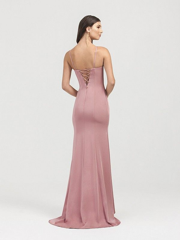 98c5af1568 ... formal gown with a lace-up back and kick train. This beauty is both  form fitting and figure flattering