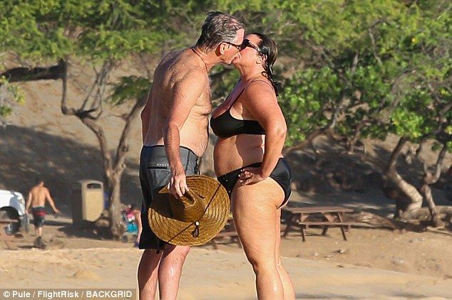 Loved-up Pierce Brosnan kisses wife Keely Shaye Smith in Hawaii #dailymail