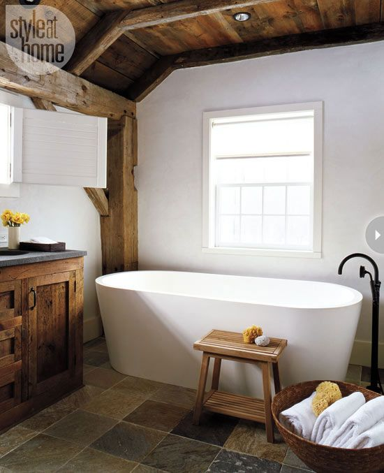 Modern rustic barn If you love rustic decor, this bathroom is for you. Sticking to a rich neutral colour palette allows the wood vanity and stunning beams to shine, while the large custom tub lends a sculptural look to the space.