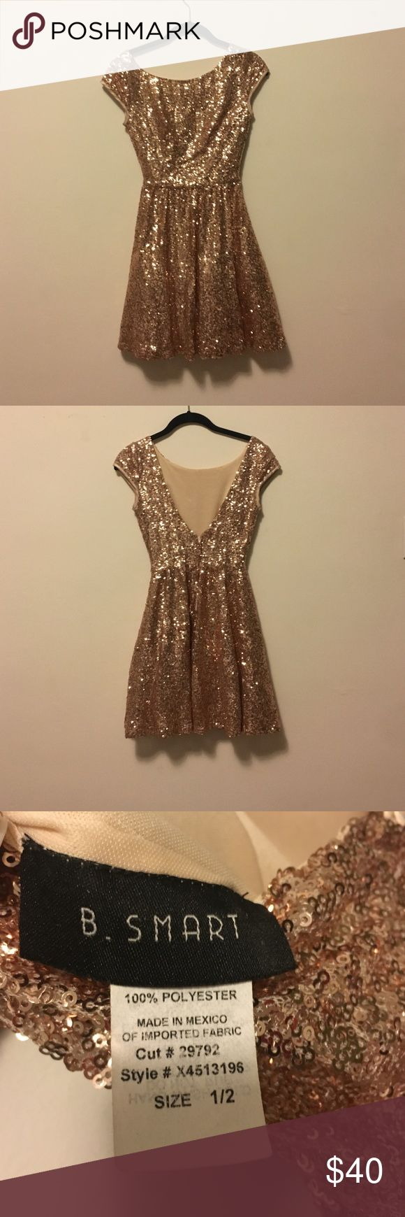 Gold Sequin Cocktail Dress CUTE, short, sequin, v-back cocktail dress. Short sleeved with zipped in the back and a petticoat underneath. Worn once. B. SMART Dresses