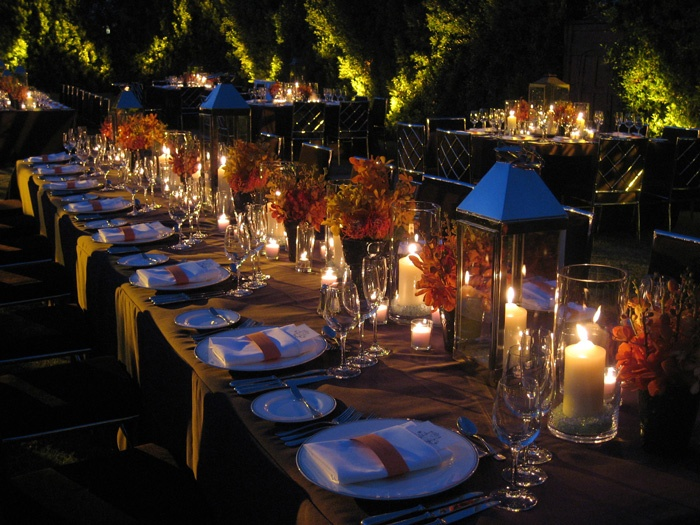 Lanterns amp candles on table w hints of orange florals rehearsal dinners outdoors