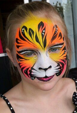 Beautiful face painting, tiger girl, by Marcela Bustamante