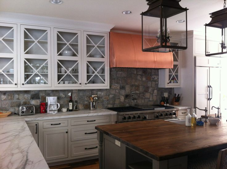 The Kitchen - Custom Cabinets and Reclaimed Wood Island Top by Specialty Woodworks Company of Hamilton, Montana, Lighting by Circa Lighting, Custom Copper Hood and the back splash which is Antique Salt and Pepper Cobblestones from Antique Brick Warehouse in Omaha Nebraska.
