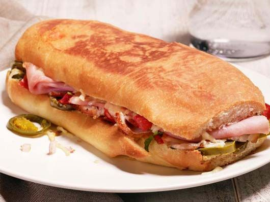 The term panini originated in Italy—panino simply means a sandwich made from bread (anything but sliced bread). The bread is cut horizontally and filled with deli ingredients such as meats, cheese and vegetables. These are different from the toasted...
