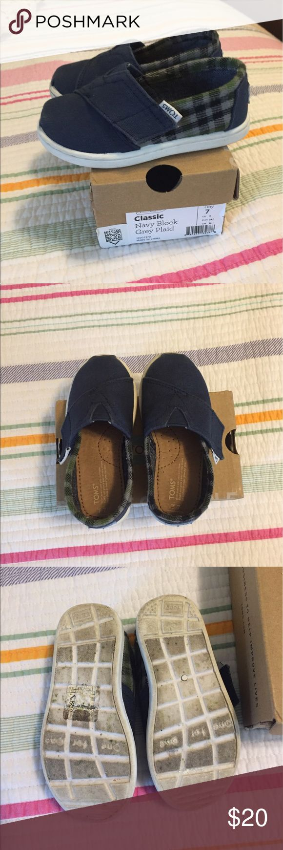 Navy play Tiny Toms size 7 These cute Tiny Toms are size 7 and in great condition. My son wore them just a few times. The bottoms aren't really worn just discolored from walking around. Velcro closure on the sides. Smoke-free home Toms Shoes Sneakers