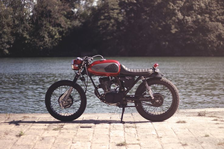 a tiny Honda C90 (?) Cafe Racer