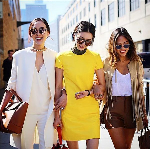 Our last but not least, the Asian domination, from left Chriselle Lim (@chrisellelim) then Irene Kim (@ireneisgood) and Aimee Song (@songofstyle) looking uber polished and chic during #FashionWeek presentations, juggling between their Instagram, Snapchats, and probably gazillion of other social media platforms. These girls are definitely running some serious business (and style!)
