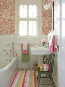 Good design utilizing limited room & layout with historical fixtures & millwork. pink green small bathroom design idea