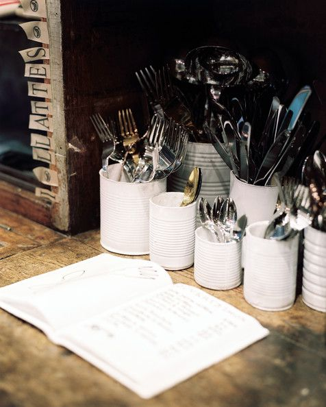 Bohemian - Flatware arranged in white cylinders on a wooden surface