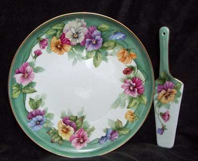Pansies on porcelain cake plate and server by porcelain artist and china painting teacher, Charlene Whitler