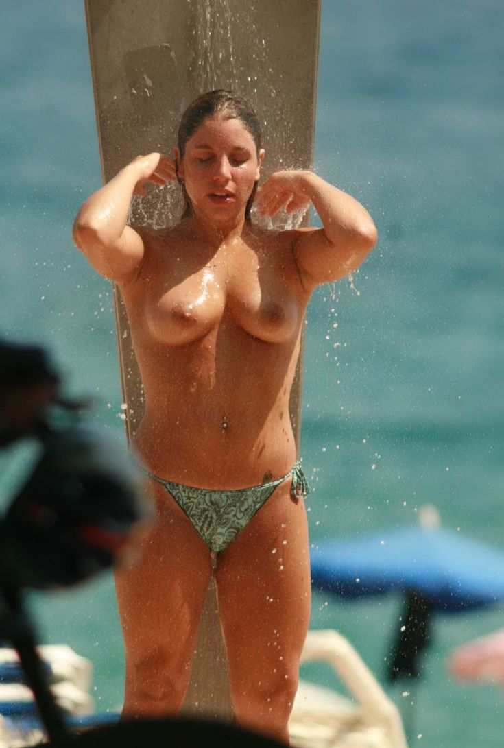 Under The Outdoor Shower A Naked Girl Stands With Her Hot Body On Display