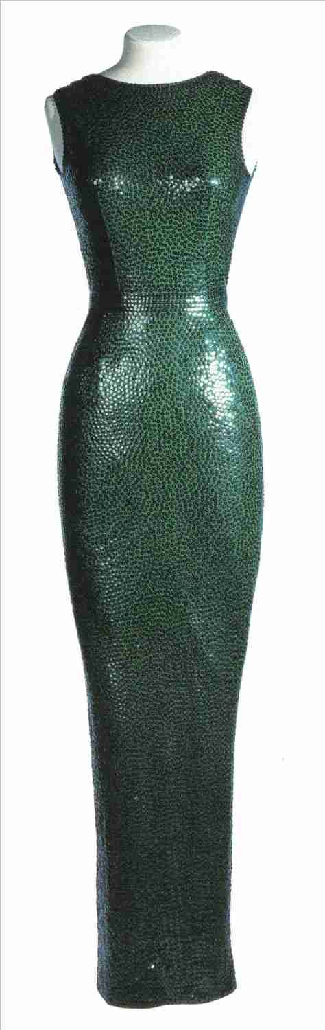 "||Lot 53 - A SEQUINED EVENING DRESS  The backless, full-length dress of emerald green jersey, heavily embroidered with matching sequins, decorated with inset waistband.  Unlabeled, by Norman Norell, worn by Marilyn Monroe at the Golden Globe Award Ceremonies in Hollywood on March 5, 1962, when accepting her award as 1961's ""World's Favorite Film Star."""