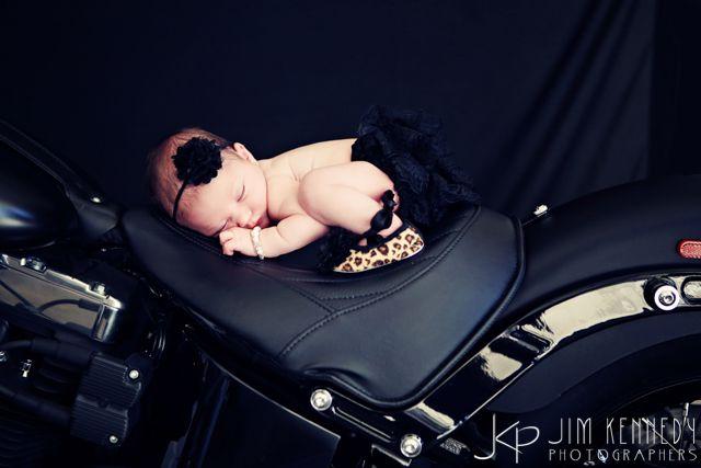Precious newborn baby on motorcycle!   Jim Kennedy Photographers