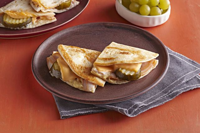 Crunchy pickle chips and melted cheese give this Cuban Turkey Quesadilla for two its unique flavor and texture.