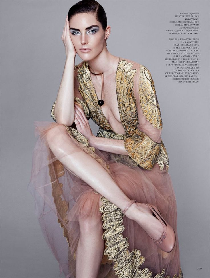 Taking a seat, Hilary Rhoda wears Valentino dress and flats for Harper's Bazaar Magazine Kazakhstan December 2016 edition