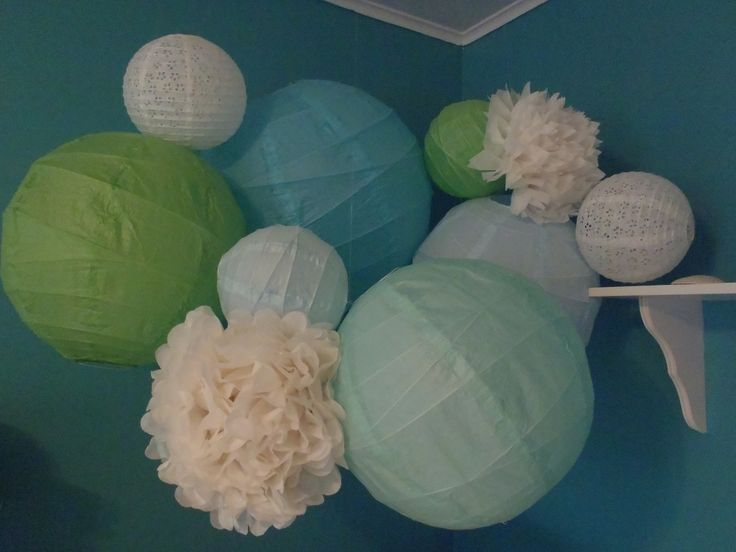 Paper lanterns and poms- DIY room decoration. Perfect for any theme. This was specifically for my daughter's under the sea room.