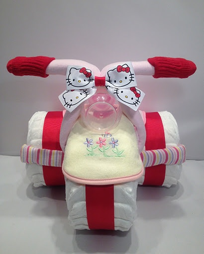 Kitty cat diaper cake http://babyfavorsandgifts.com/diaper-cakes-baby-girl-c-3_22.html