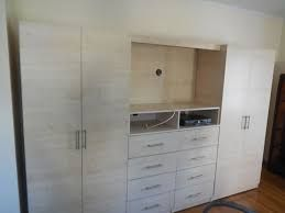 Bedroom Entertainment Unit With Wardrobe Cabinets And TV Space