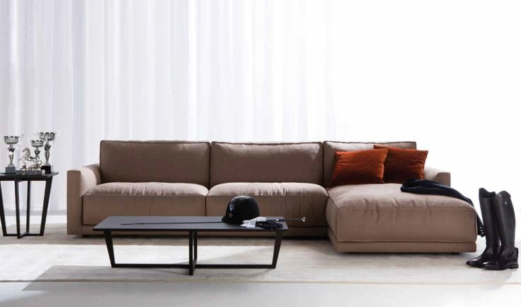 """Fashionable and precious, Ribot is the modern leather """" sofa"""" above all: seat cushions comfortable and always perfect, high back that sustains and receives, pinched seams (""""paperina"""") that sketch the outlines and exalt the volumes as a dress of haute couture dress-maker's."""