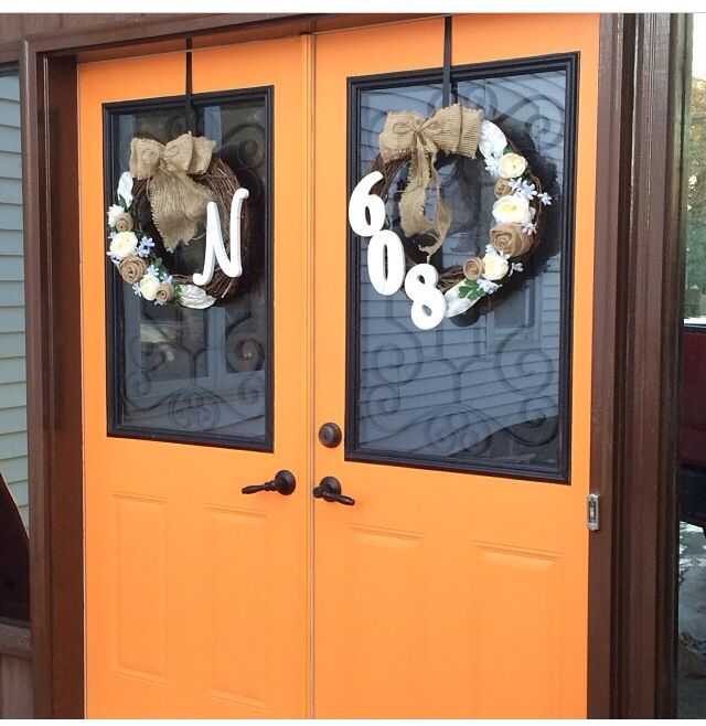 Burlap roses and bows. Double door wreaths neutral colors. Monogram and house number