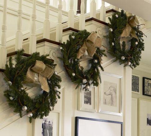 Christmas wreaths on staircase: Christmas Wreaths, Christmas Decor Ideas, Jingle Belle, Christmas Stairs, Christmas Stairca, Burlap Bows, Garlands, Holidays Decor, Pottery Barns