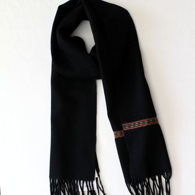 This black wool twill woven scarf with eye-catching tribe purfle will complement any wintry outfit, particularly those with muted, neutral tones. Generous size and floppy drape. Wearable with everything and every color including black itself as below.