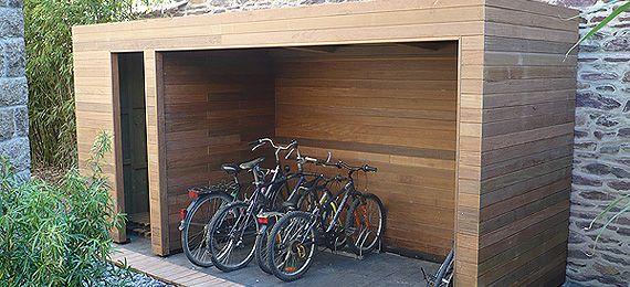 Un abri de jardin : si on le ferme par deux portes, un local de stockage sobre et plutôt beau