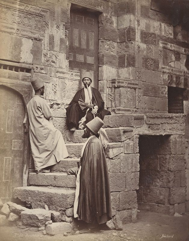 An albumen print of Dervishes in Egypt.   The Sufi order 'Mevlevi' was founded in 1273 by followers of Jalal al-Din Muhammad Rumi at Konya in present day Turkey, where Rumi is buried. Commonly known as 'Whirling Dervishes', their influence spread from the Balkans though Syria and Egypt during the Ottoman period.