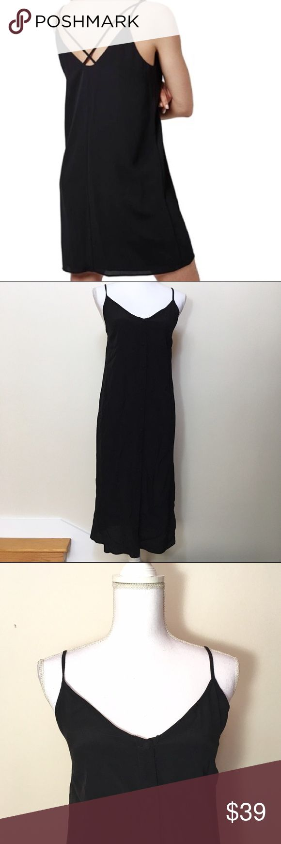 NWT Topshop front button black dress cross back 4 This Topshop dress is a cross between 90s grunge and grown up glamour. It's very easy to dress it up or leave it as simple summer dress. Lightweight not lined. Front button closure and crossed straps make it even more special. Sz 4 Brand new with tags attached. Topshop Dresses