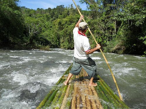 Bamboo Rafting. Drifting down stream on bamboo raft at Amandit River, Loksado - South Kalimantan - Indonesia