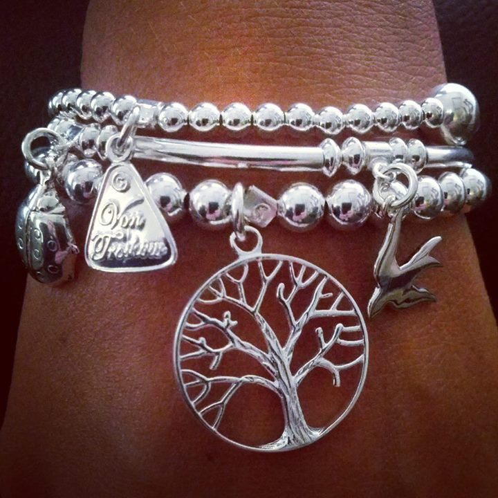 The TREE OF LIFE Von Treskow stretchy strands are harmonized with charms and sterling silver. Strands can be worn individually or together as a set.
