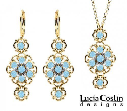 Lucia Costin 14K Yellow Gold over .925 Sterling Silver Pendant and Earrings Set with Twisted Lines and Sterling Silver 6 Petal Flowers, Garnished with Dots and Light Blue Swarovski Crystals; Handmade in USA Lucia Costin. $125.00. Unique and feminine, perfect to wear for special occasions and evenings. Produced delicately by hand, made in USA. Embellished with aquamarine Swarovski crystals. Feminine floral design. Lucia Costin jewelry set