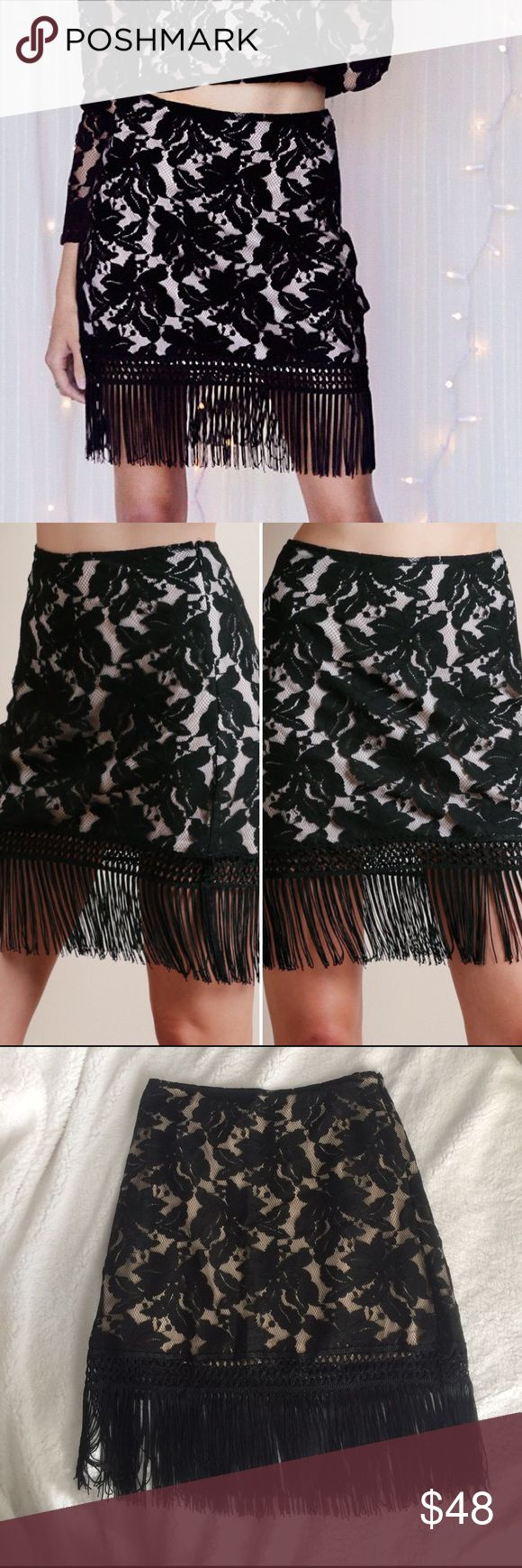 """Lace and fringe mini skirt Super cute lace and fringe mini skirt. Black lace overlay with nude colored lining. Fully lined  (except the fringe part). Side zipper. Skirt and lining is approximately 14"""" long. Fringe is approximately 6"""" long. New with tags! 40% cotton, 30% nylon, 30% silk. Lining is 100% polyester. Honey Punch Skirts Mini"""
